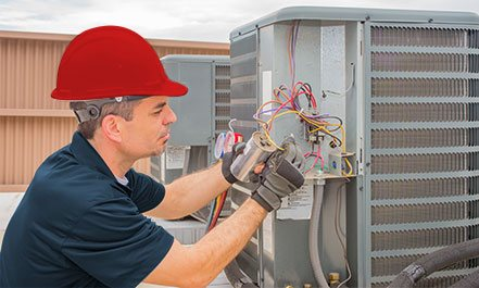 Electrician Repairing Heating