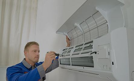 AC Specialist Checking Air Conditioner